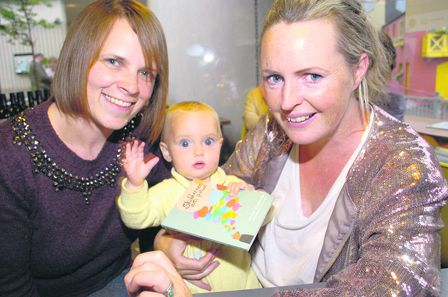 Eight-months-old Beau Montgomery-Callaghan admires the programme for the 2015 Skibbereen Arts Festival with her mum, Susan Montgomery from Clonakilty, and Sarah Ruttle, Ballydehob, at the festival launch at Kalbos Uillinn on Tuesday evening. The Southern