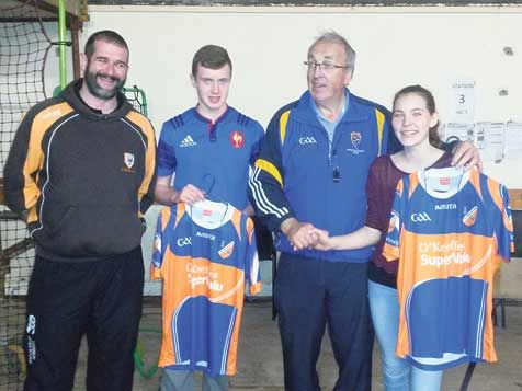 Prize winners: Paudie Butler presents the competition winners with their jerseys at the launch of Cill Mochomóg.