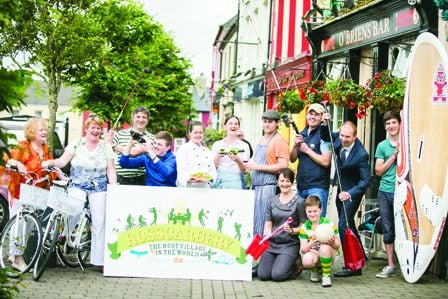 Business people and residents of Rosscarbery at the unveiling of the villages confident new logo (inset) and tagline.