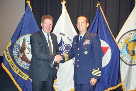 Michael Kingston with Captain John Mauger, commanding officer, US Coastguard Maritime Safety Centre, as Michael receives the US Coastguard Challenge Coin Medal at the U S National Naval Memorial Centre, in Washington DC