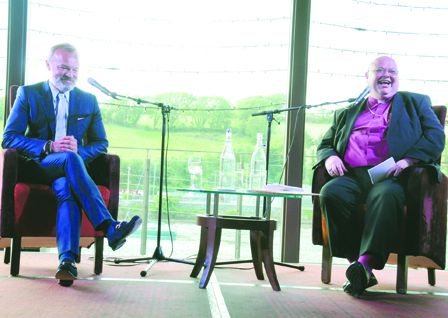 Graham Norton on stage with Bishop Paul Colton at the Maritime Hotel last Friday night.