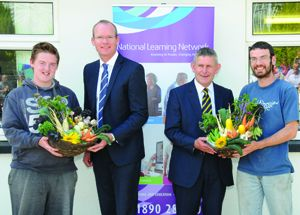 Making a presentation of produce grown in the polytunnels at NLN Bantry, to guest speakers Minister Simon Coveney and CEO of CETB Ted Owens, following the presentation of certifiates to graduates of the centres first Food Production course.