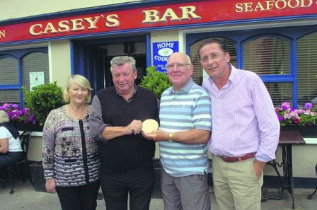 Frank Fahy holding his gran-uncle Patrick Collins memorial plaque, with Michael and Martha Casey and Paul Heaphy of Caseys Bar in Union Hall.