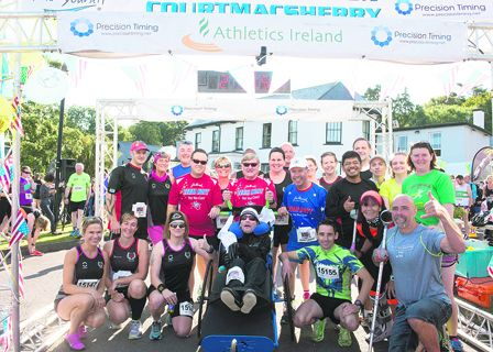Race organiser Bob Hilliard gives the thumbs up with Team Hoyt at the beginning of the marathon in Courtmacsherry.