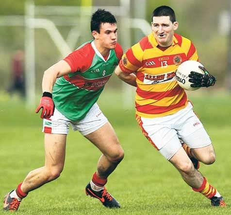 Flashback to 15 weeks ago: Newcestowns Daniel Twomey is challenged by Clonakiltys Thomas Clancy during the Cork county senior football championship round one game at Dunmanway last May.(