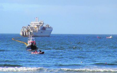 Ballinspittle man Joe Brennan took this photo from Garretstown beach on Monday last of the laying of the transatlantic cable for high speed internet, between Somerset and Nova Scotia, which came ashore here to create a link for Ireland