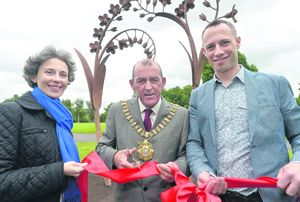 Suzanne Lyle, Arts Council of Northern Ireland, with Lord Mayor of Belfast, Cllr Arder Carson, and artist Alex Pentek at the Forget Me Not sculpture.