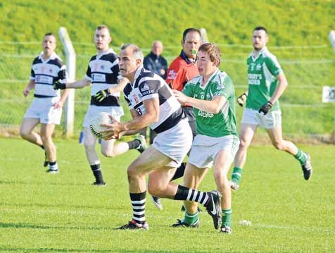 David Brosnan of St Nicks being tackled by Eoin Lavers of Dohenys in the drawn game last Saturday evening.