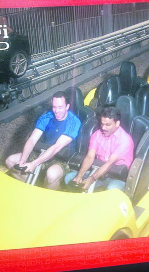 Liam Murphy with Shakiha on the rollercoaster at the Ferrari World theme park