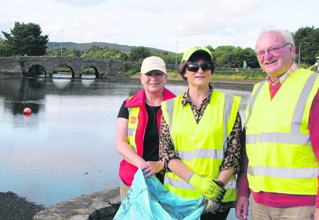 Tidy Towns volunteers Lorraine Swanton, Ann Redmond and John Forde taking part in one of the Wednesday evening clean-ups in  Ballydehob.