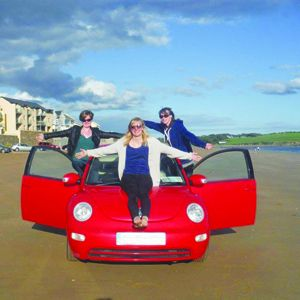 Bebeanne, left, with Corinne and Gina, and Hairy Coo the red VW Beetle on yet another beach! Below: at various stops on their epic trip around Irelands top attractions