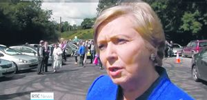 Justice Minister Frances Fitzgerald speaking on the RTE News last Sunday evening, with the doughnuts clearly visible in the background