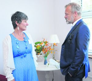 Tricia Lyne, ARC co-ordinator for West Cork, chatting to Graham Norton, guest of honour, at the official opening of the ARC Cancer Care Centre in Bantry on Thursday of last week.