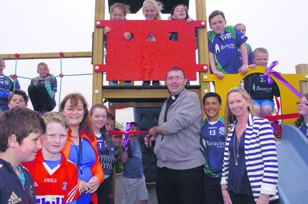 Fr Chris ODonovan cutting the tape to officially open the new Rath National School Playground funded by the Parents Association. Included in the photo are principal Maura Collins and Ruth Field, chairperson, Parents Association