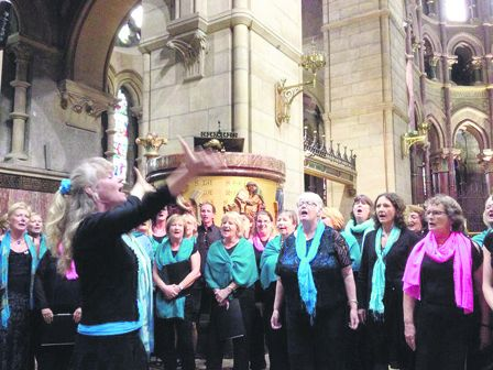 Caz Jeffreys leading her choirs in concert at St Finbarrs Cathedral in Cork earlier this summer.