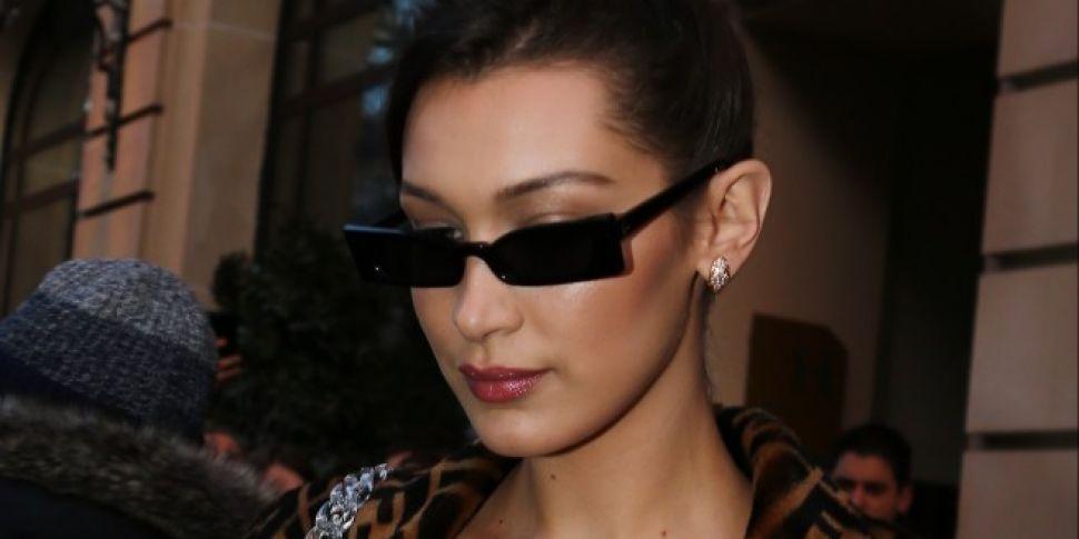 Bella Hadid Denies Kissing The...