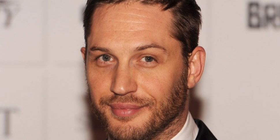 There Is An Instagram Account Dedicated To Tom Hardy Holding Dogs