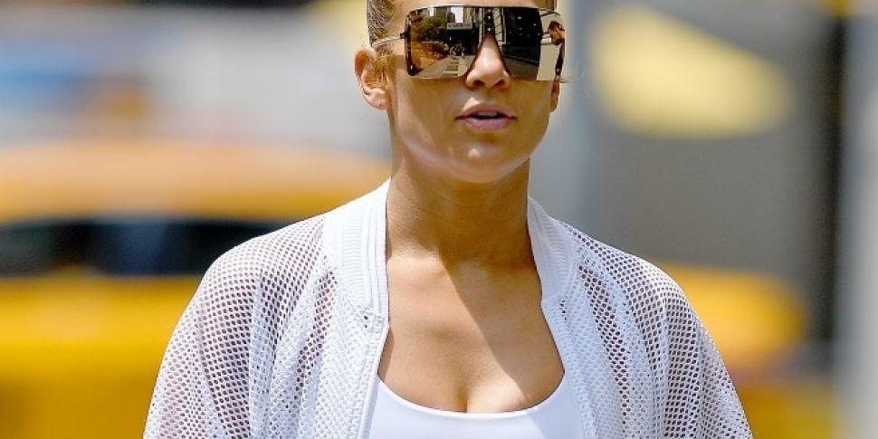 Jennifer Lopez Gets On A Table...