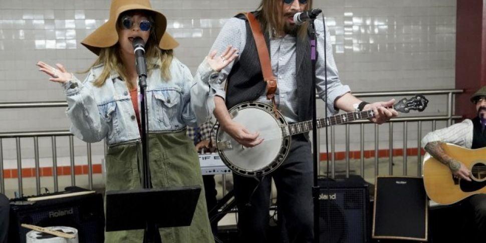 Christina Aguileria And Jimmy Fallon Busk In New York Subway