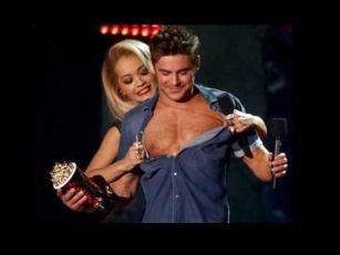Rita Ora strips Zac Efron