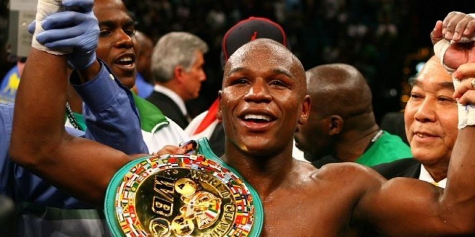Mayweather Outpoints Pacquaio...