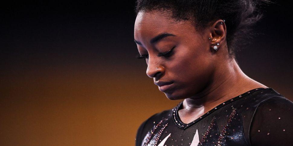 Simone Biles withdraws from tw...