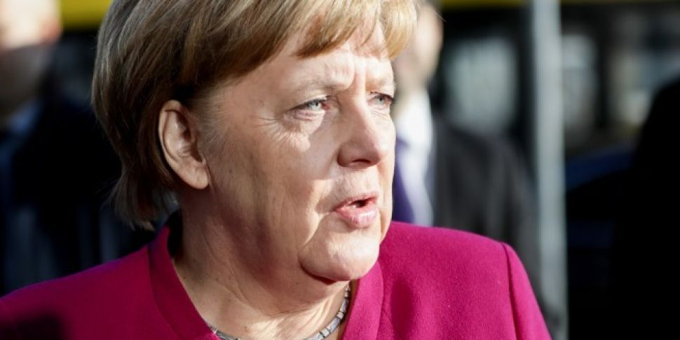 Angela Merkel to Stand Down as...
