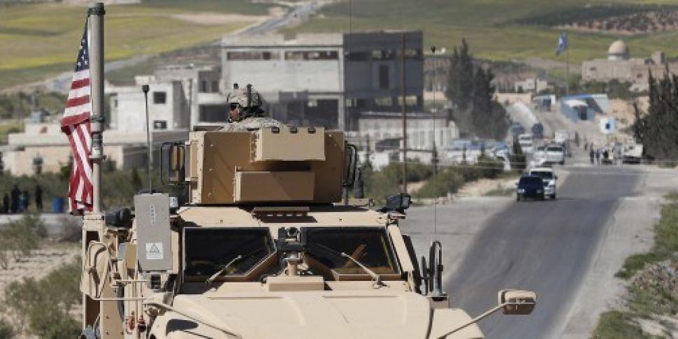 Trump Still Wants US Troops In...